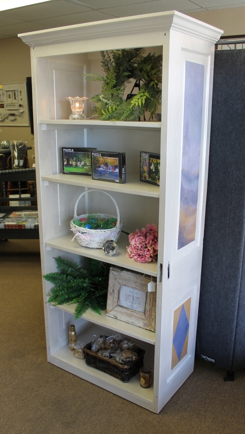 Shelving from a reclaimed door - by Ronald and Chris Davis