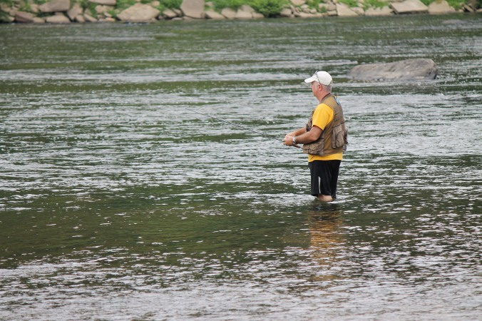 A angler tries his luck near the bridge on Farmers Fish
