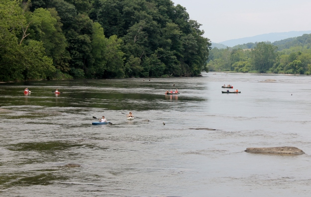 canoes and kayaks navigate the New River